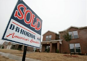 A D.R. Horton home builder sold sign sits in front of a newly built home in the Kingston Meadows development in Glenn Heights, Texas, in this Jan. 20, 2007 file photo. D.R. Horton, one of the nation's largest homebuilders, said Thursday, April 19, 2007 its fiscal second-quarter earnings...