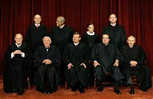 Members of the U.S. Supreme Court sit for a group portrait at the Supreme Court in Washington in this March 3, 2006 file photo.