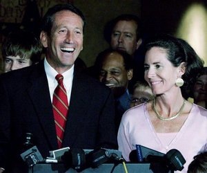 This June 13, 2006, file photo shows South Carolina Gov. Mark Sanford smiling as he is joined by his wife, Jenny, after he won the Republican gubernatorial nomination, in Columbia, S.C.