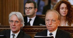 Rupert Murdoch sits alongside Les Hinton in London. Behind them are Andy Coulson and Rebekah Wade, both former editors of the News of The World. Coulson is now a top adviser to the Tory Party.