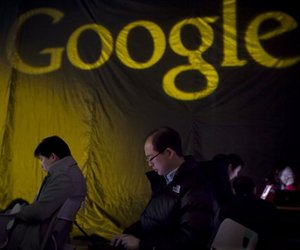 In this March 30, 2009 file photo, people use laptops at a ceremony to launch Google's free music download service for China in Beijing.