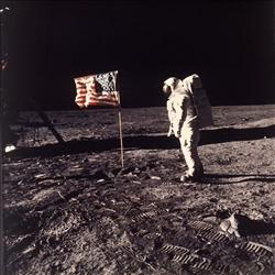 Moon dust nearly ruined this iconic photograph, when the ground proved so hard that Neil Armstrong and Buzz Aldrin could barely plant a flagpole.