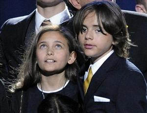Paris Jackson and Prince Michael Jackson I stand together on stage during the memorial service for  Michael Jackson at the Staples Center in Los Angeles last month.