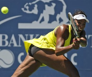 Venus Williams returns to Marion Bartoli, of France, during the final of the Bank of the West tennis tournament in Stanford, Calif., last week.