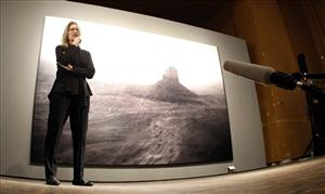 Annie Leibovitz stands in front of her work 'Monument Valley, Arizona 1993.'