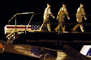 An Army carry team walks away from a transfer case containing the remains of Army Cpl. Nicholas R. Roush on Monday, Aug. 17, 2009 at Dover Air Force Base, Del.