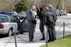 State and local police wait for a building to be cleared by police on the Virginia Tech campus in Blacksburg, Va., Monday, April 16, 2007, following a shooting incident. Police said the shootings have left at least 20 people dead and a similar number injured. (AP Photo/Don Petersen)