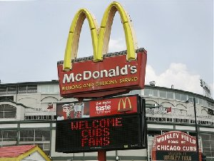 A McDonalds's sign across from Wrigley Field, home of the Chicago Cubs, welcomes fans Thursday, May 24, 2007, on Chicago's North Side. McDonalds Corporation executives, meeting Thursday for their annual shareholder meeting, said the company is also looking at creative ways to integrate fruits and vegetables to their menu. (AP...