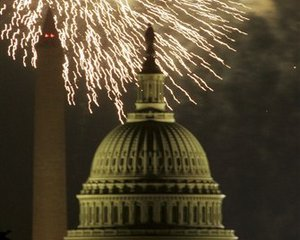 The U.S. Capitol and Washington Monument, rear left, are illuminated as fireworks explode, Wednesday, July 4, 2007, in Washington. (AP Photo/Haraz N. Ghanbari)