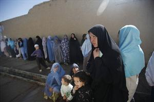 Afghan women voters line up to cast their ballots at a mosque made into a polling station in Kabul on Thursday Aug. 20, 2009.