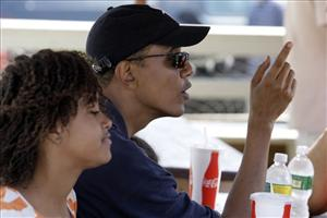 President Obama, with daughter Malia, 11, waits for lunch at Nancy's yesterday in Oak Bluffs, Mass.