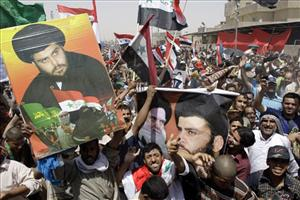 Supporters of anti-US cleric Muqtada al-Sadr rally against a US-Iraqi security pact in the Shiite stronghold of Sadr City in Baghdad, Iraq.