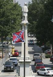 The Confederate flag flutters above downtown Columbia, SC, last year.