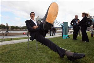 Sultan Kosen of Turkey poses in front of Tower Bridge today in London. He stands 8 feet, 1inch tall and also holds the record for the largest hands and largest feet.