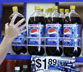 A customer takes a bottle of Pepsi from a display at T & P Grocery in Hosford, Fla., on April 21, 2008.