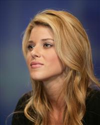 This April 26, 2009 file photo shows Miss California Carrie Prejean listening to a question during a visit to the Rock Church during services in San Diego.