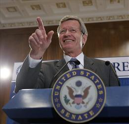 Senate Finance Committee Chairman Sen. Max Baucus speaks to reporters Wednesday.