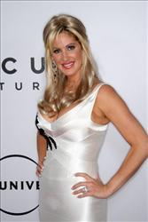 Kim Zolciak arrives at the NBC, Universal Pictures and Focus Features' after party for the 66th Annual Golden Globe Awards at the Beverly Hilton Hotel on January 11, 2009 in Beverly Hills, California.