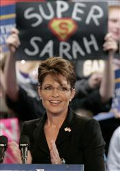 Sarah Palin, then governor of Alaska, claps along with the crowd before she addresses a campaign rally in Erie, Pa., last year.