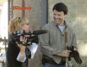 In this Dec. 27, 2006 photo provided by the National Enquirer, former US Sen. John Edwards, D-NC, is shown with videographer Rielle Hunter in the 9th Ward of New Orleans, La.