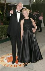 John Cleese and then-wife Alice Faye Eichelberger arrive at the 2007 Vanity Fair Oscar Party at Mortons on February 25, 2007 in West Hollywood, California.