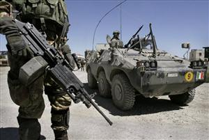 Italian NATO soldiers stand ready on the outskirts of Kabul, Afghanistan.