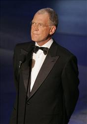 In this Sept. 18, 2005 file photo Late night talk show host David Letterman makes a surprise appearance at the Primetime Emmy Awards in Los Angeles.
