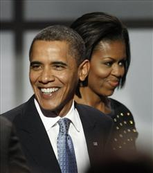 Barack and Michelle Obama on the South Lawn of the White House Tuesday, Oct. 13, 2009, in Washington.