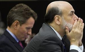 Federal Reserve chair Ben Bernanke, right, during a break at the G20 Finance Ministers meeting in St. Andrews, Scotland Nov. 7, 2009. Treasury Secretary Timothy Geithner is at left.