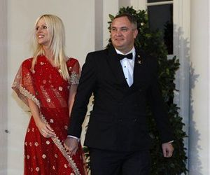 Michaele and Tareq Salahi, right, arrive at a State Dinner hosted by President Barack Obama for Indian Prime Minister Manmohan Singh, Nov. 24, 2009.