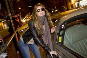 Rachel Uchitel gets into a car in front of her home in New York, Sunday, Nov. 29, 2009.