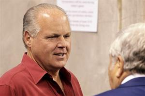 Talk radio host Rush Limbaugh is seen on the sideline before the start of an NFL football game between the New England Patriots and the Indianapolis Colts Sunday, Nov. 15, 2009, in Indianapolis.