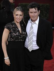 In this Sunday, Sept. 20, 2009, picture, actor Charlie Sheen, right, and wife Brooke Mueller arrive at the 61st Primetime Emmy Awards in Los Angeles.