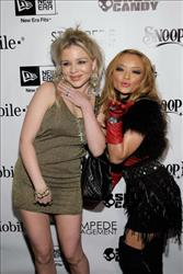 Tila Tequila and Casey Johnson attend the Famous Stars and Straps 10th Anniversary and Snoop Dogg's 10th album release 'Malice N Wonderland' party on December 8, 2009 in Hollywood, California.