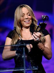 Mariah Carey accepts the Breakthrough Actress Performance award onstage at the 2010 Palm Springs International Film Festival gala on January 5, 2010 in Palm Springs, California.