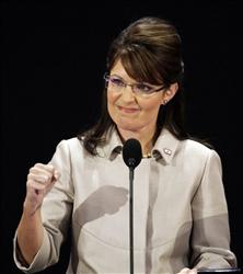 Then-Republican vice presidential candidate Sarah Palin, pumps her fist during her speech at the 2008 Republican National Convention in St. Paul, Minn.