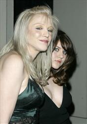 In this Feb. 8, 2007 file photo, singer Courtney Love and her daughter Frances Bean Cobain arrive at an event honoring Gianni Versace and his sister Donatella Versace in Beverly Hills, Calif.