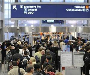 Passengers wait in a security line at O'Hare International Airport in Chicago, Monday, Jan. 4, 2010.