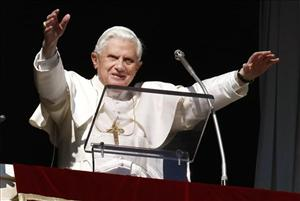 Pope Benedict XVI delivers a blessing from the window of his studio overlooking St. Peter's square at the Vatican.