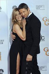 Jennifer Aniston, left, and Gerard Butler are photographed backstage at the 67th Annual Golden Globe Awards on Sunday, Jan. 17, 2010, in Beverly Hills, Calif.