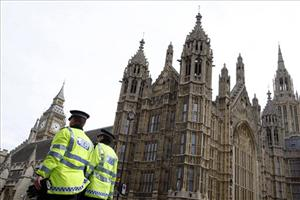 Police officers patrol near Parliament in London, April 10, 2009. The UK terror alert level was raised today to the second-highest designation, which means an attack is highly likely.