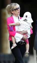 In this Aug. 6, 2009 file photo, Rielle Hunter leaves the courthouse in Raleigh, NC. Former  presidential candidate John Edwards has finally come forward to admit that he fathered Hunter's child.