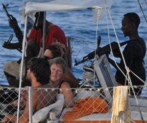 Armed pirates and their hostages are seen aboard a French yacht off the coast of Somalia in this 2009 photo.