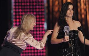 Actresses Sandra Bullock, left, and Meryl Streep are seen on stage as they accept the best actress award at the 15th Annual Critics Choice Movie Awards on Friday, Jan. 15, 2010, in Los Angeles.