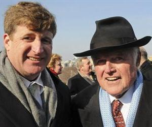 Sen. Edward Kennedy, D-Mass., poses for a picture with his son, Rep. Patrick Kennedy, D-RI, at the inauguration of President Barack Obama.