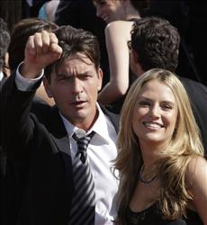 Actor Charlie Sheen with his wife Brooke Mueller arrive at the 59th Primetime Emmy Awards, file photo dated Sept. 16, 2007, at the Shrine Auditorium in Los Angeles.