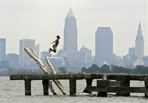 Cleveland is No. 1. Here, a young man leaps into Lake Erie off an old pier west of downtown.
