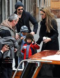 Actors Angelina Jolie, right, and Brad Pitt, second left,are seen with children Maddox, left, Shiloh Nouvel, in Venice, Tuesday, Feb. 16, 2010.