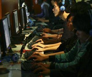 People use computers at an Internet cafe in China in this file photo.