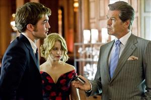 Robert Pattinson, Emilie de Ravin, and Pierce Brosnan in a scene from Remember Me.